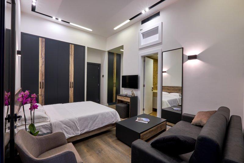 sala de estar y área de estudio de la cama
