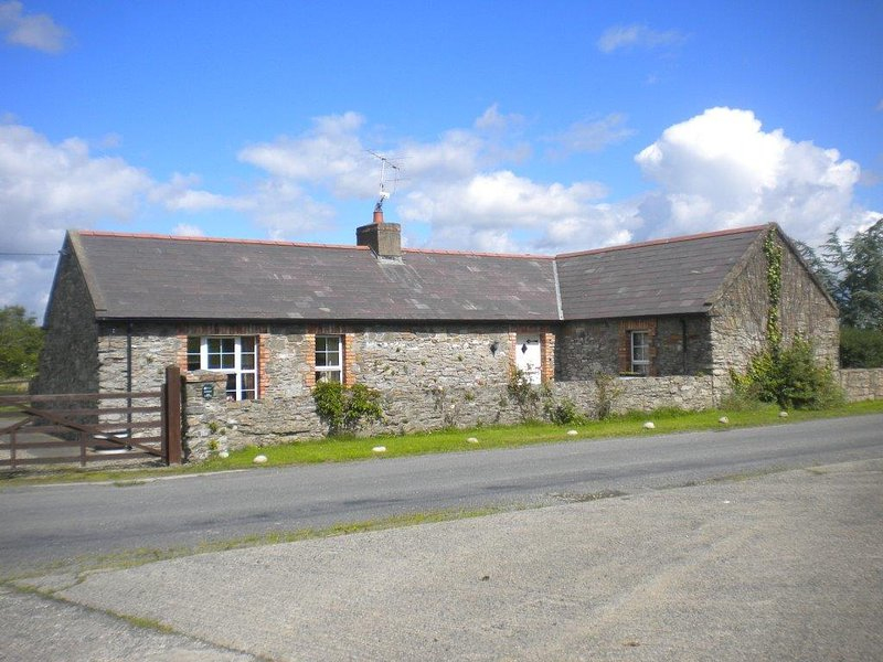 Quaint 250yr old stone cottage outside Downpatrick. Beaches, golf, historic houses/castles nearby.