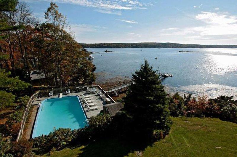 Inground pool and private dock located on beautiful Linekin Bay