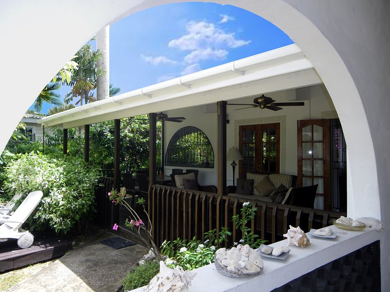 Generous verandah - dine, relax, entertain - comfy seating for 11 people here.