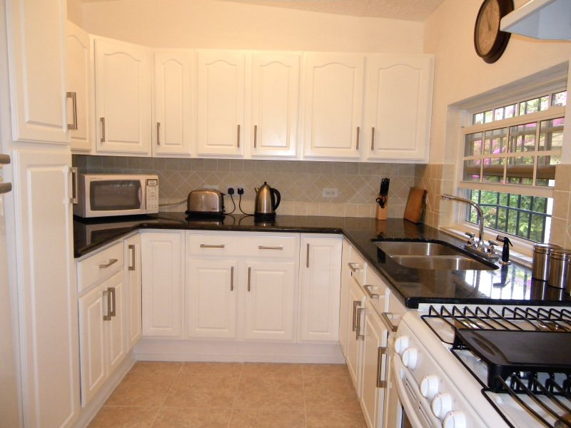 Smart kitchen, well equipped with appliances, crockery, cutlery, pots, pans etc.