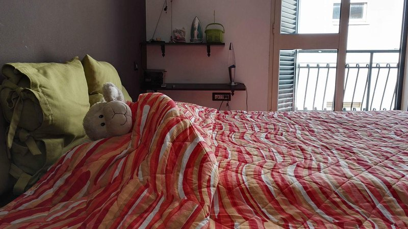 Sovrum med dubbelsäng och bäddsoffa