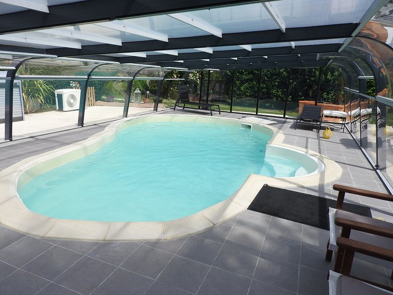 The heated swimming pool with a swimming against the current, the water is treated with active oxygen