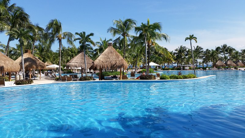 Rent a palapa or take advantage of the umbrellas as you relax by the pools.