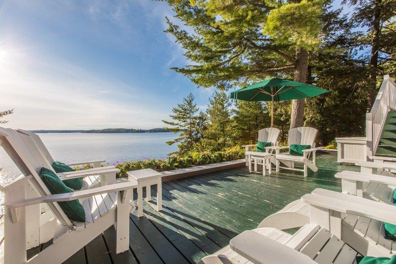 More deck seating overlooking lake