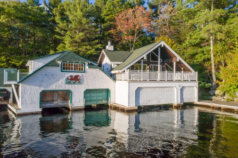 Boathouse with accommodations with porch overlooking the water