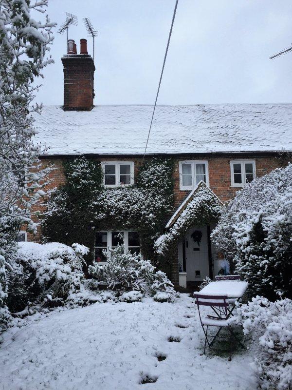 Fox Cottage in winter snow.