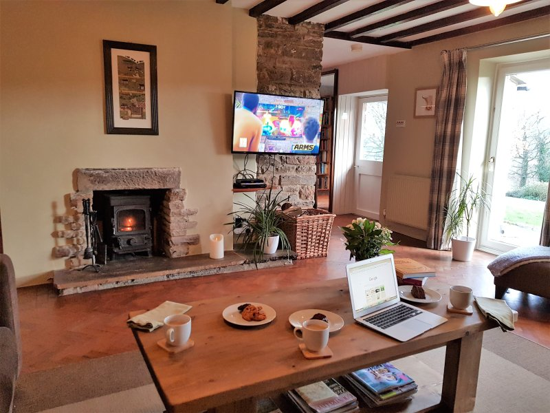 Cosy downstairs living area with log burning stove and stunning moorland views