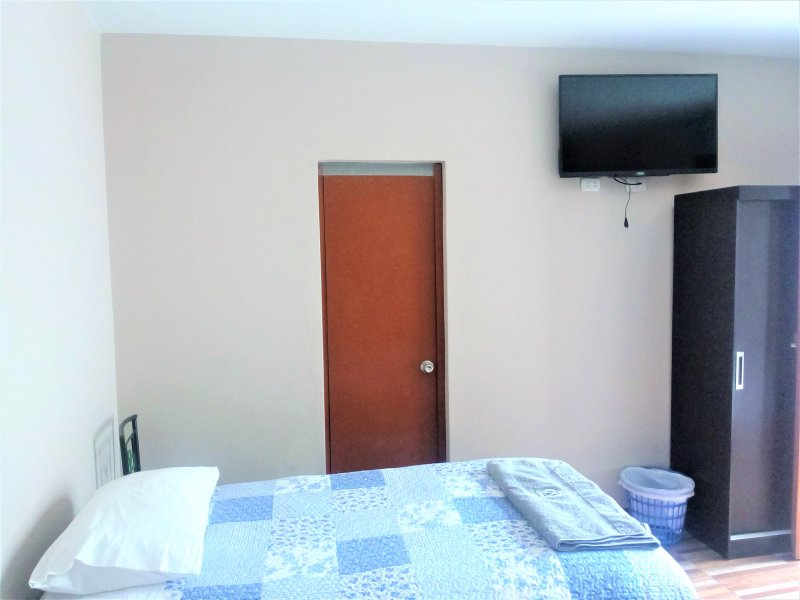 Room 03 beds, each bed and half square. With private bath, hot water, tv.cable, wifi
