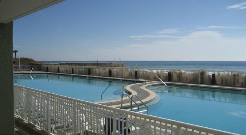View of the large heated freshwater pool & Gulf of Mexico just steps from patio.