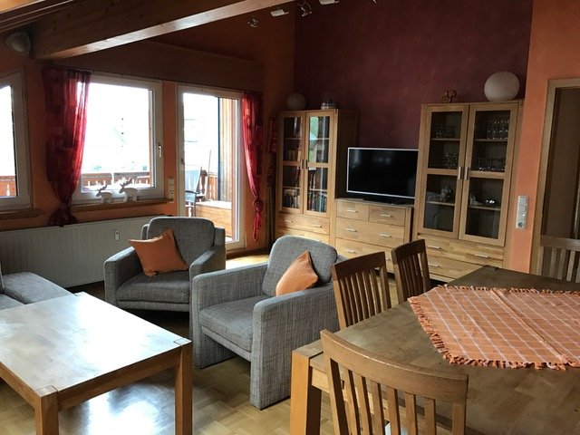 Living room with satellite TV and dining area overlooking the loggia
