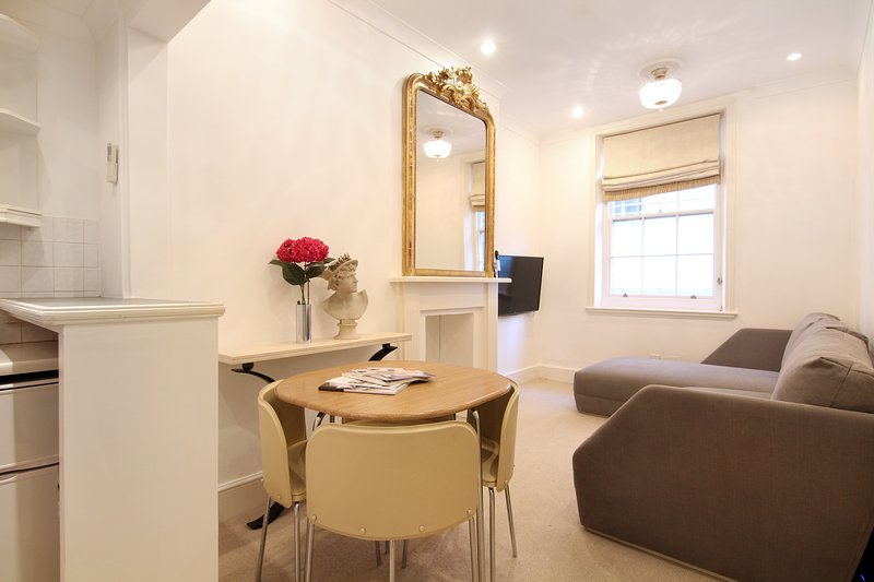 The newly furnished, cosy Lounge and Dining Area with large, comfortable 'L' shaped sofa