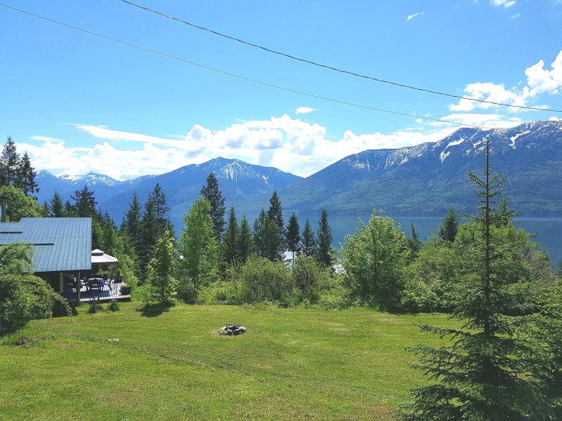 Cottage on 15 acre property, with sundeck, firepit, trails, lake and mountain view, lake access.