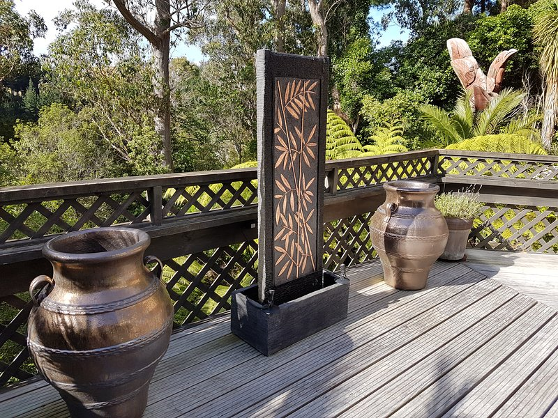 Bordello Jars, water feature and Totem Pole.
