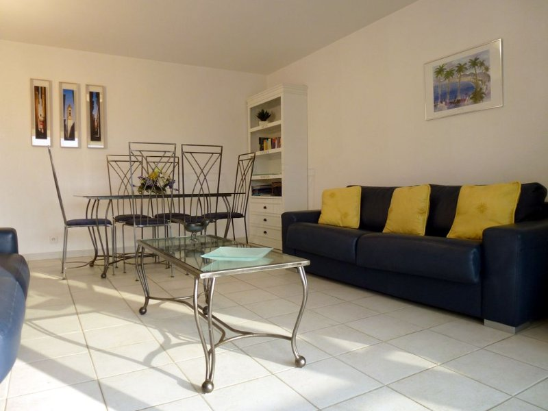 Sunny spacious living dining room with seating for 6 people Book case with info. file. Games,t.v