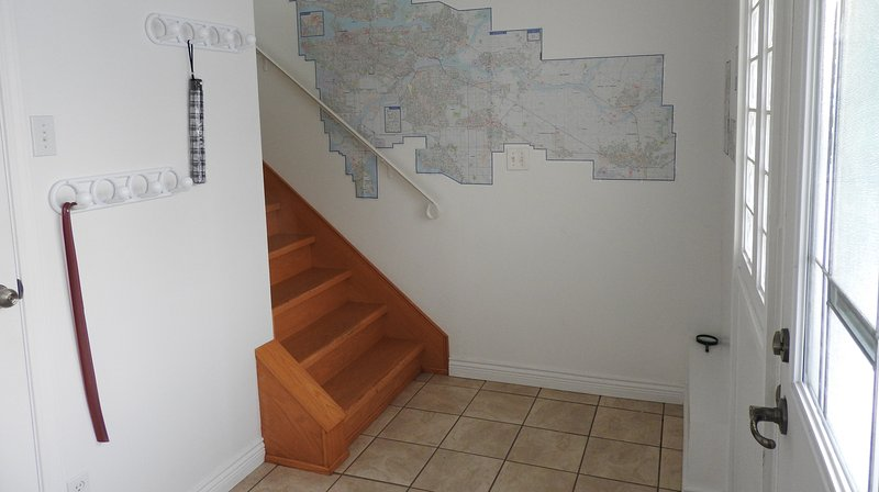 Main entrance stairwell access. A regional street map is posted in the entrance for local overview.