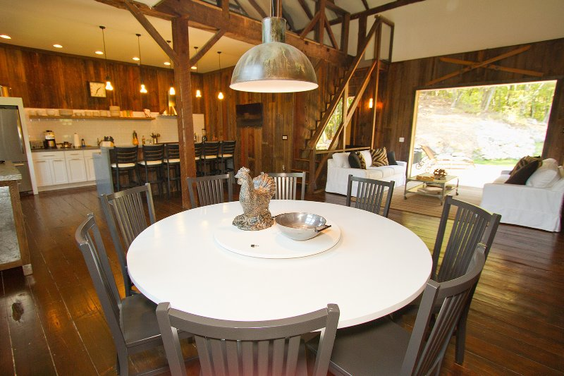 See outdoors even from the far corner dining table.  Custom 6' circular w/ built-in lazy susan.
