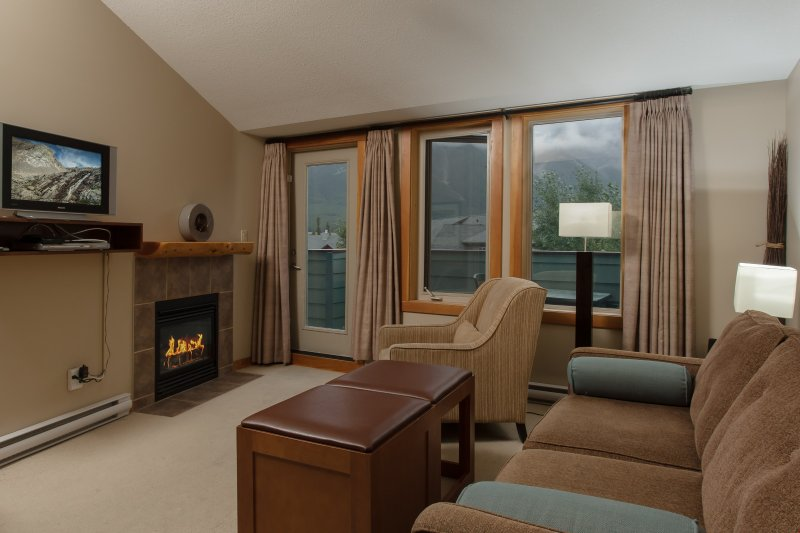 Sit back and relax in the cozy living area after a great day (views vary).
