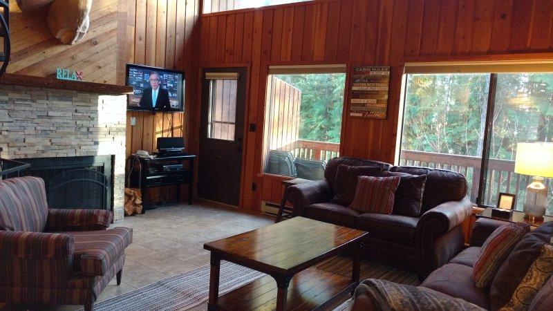 Flat screen TV, DVD, IPOD, wood burning fireplace with free wood.