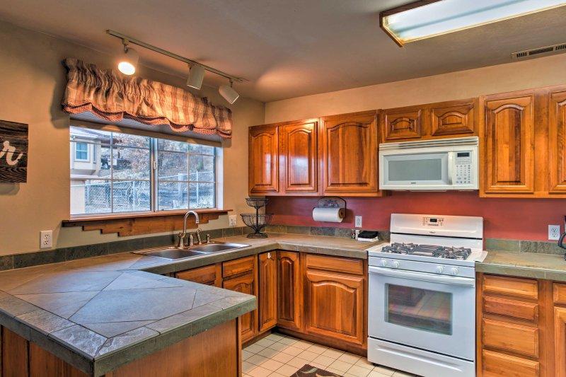 Créez des repas cuisinés à la maison avec aisance dans la cuisine entièrement équipée.