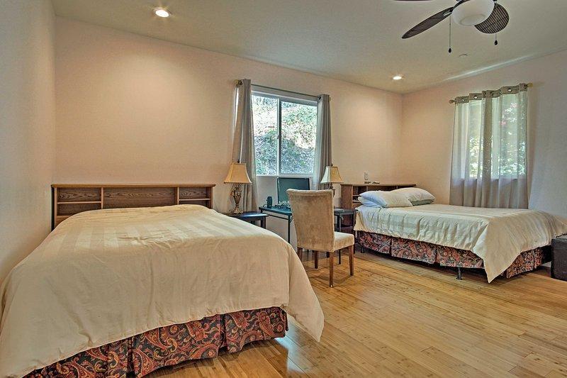 This bedroom houses 2 queen beds.
