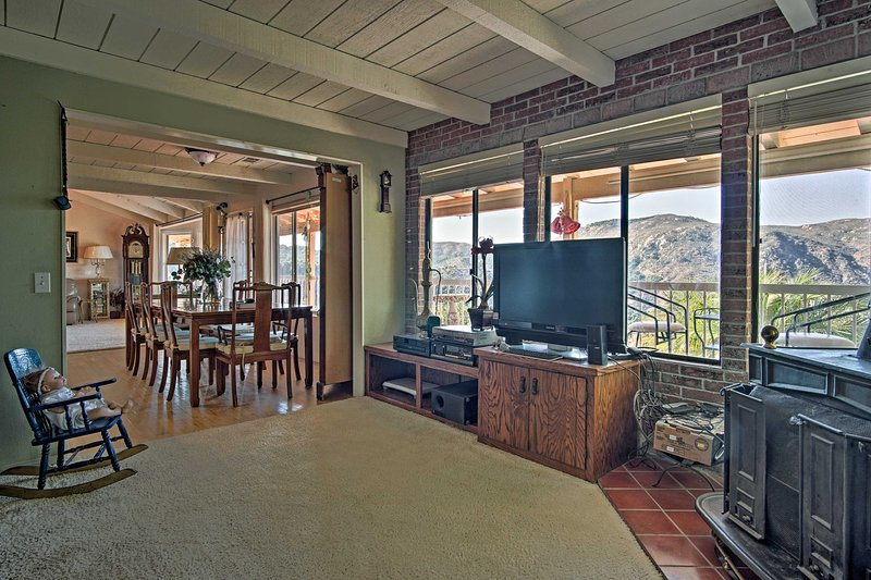 The family room has a flat-screen TV with DirecTV satellite, a selection of movies and a wood-burning stove.