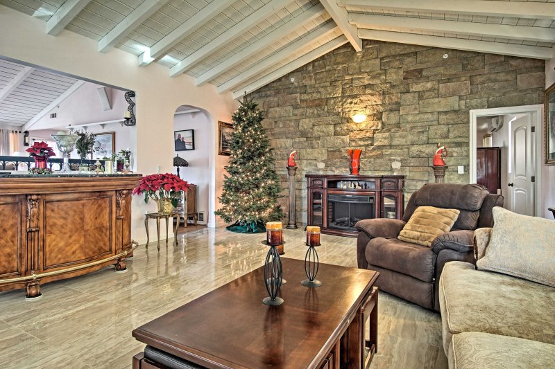 Inside, vaulted exposed beam ceilings show the true craftsmanship of this home.
