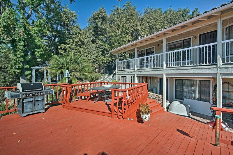 The lower deck is shared with the homeowners and their dogs, with a gas grill and bench seating!