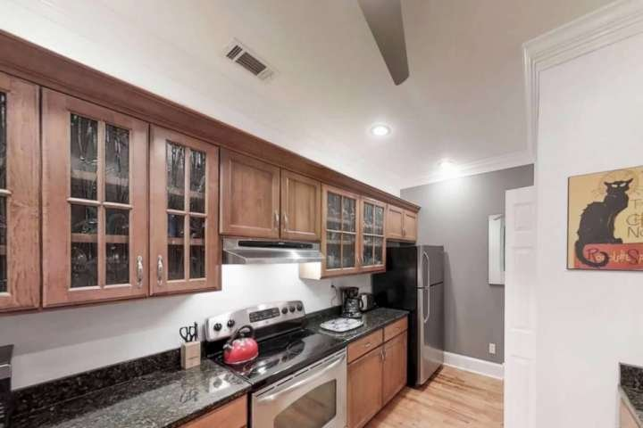 Kitchen features modern stainless steel appliances