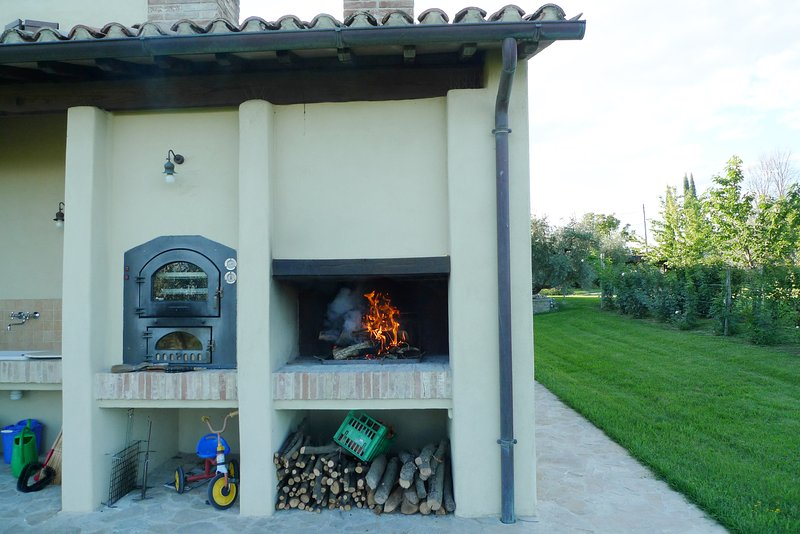 the pizza oven and the barbecue