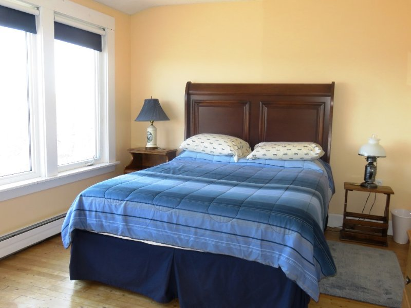 Master bedroom features a queen size bed