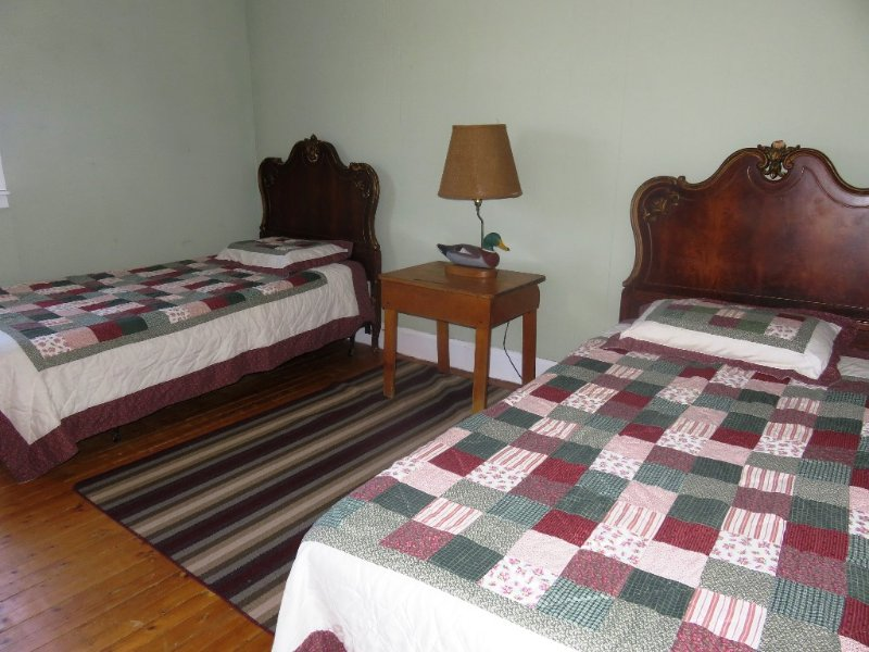 Third bedroom features two twin size beds