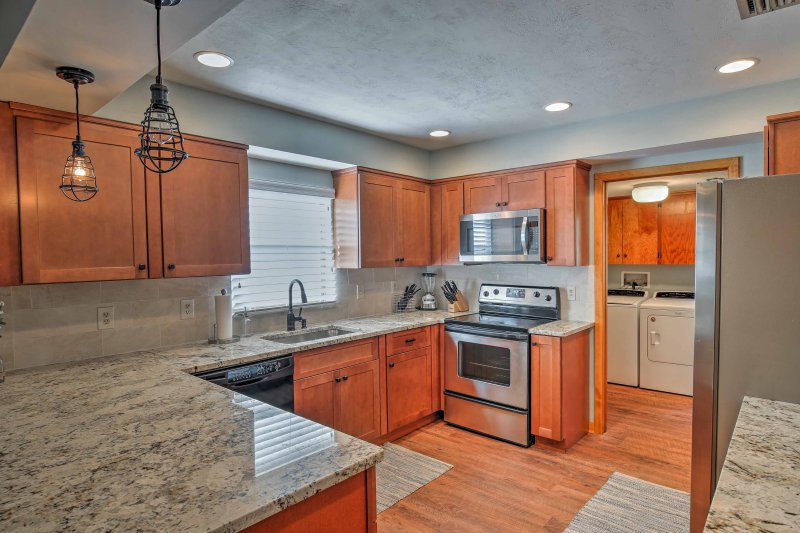 The stainless steel appliances and granite countertops enhance your cooking.
