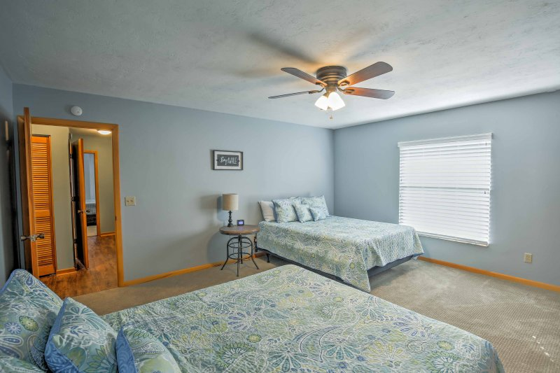 Up to 4 travelers can claim this third bedroom with 2 queen beds.