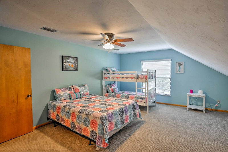 This home offers 2 bedrooms with at least 3 beds each.