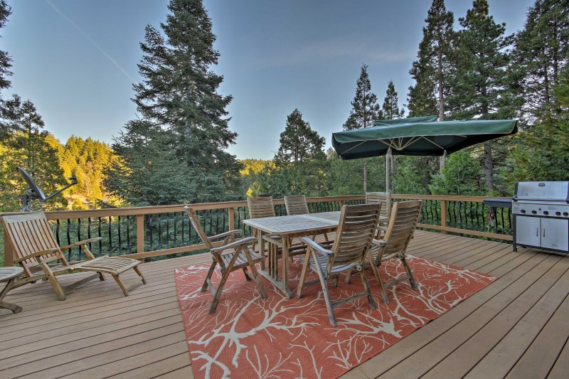 Boasting a furnished patio and beautiful views, this 1,900-square-foot cabin for 6 is both rustic and luxurious.