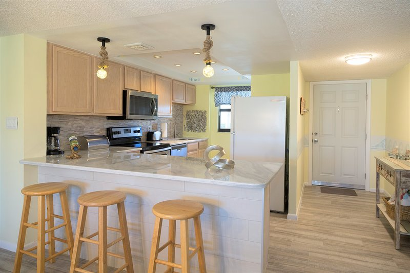 Fully equipped and spacious kitchen with granite countertops