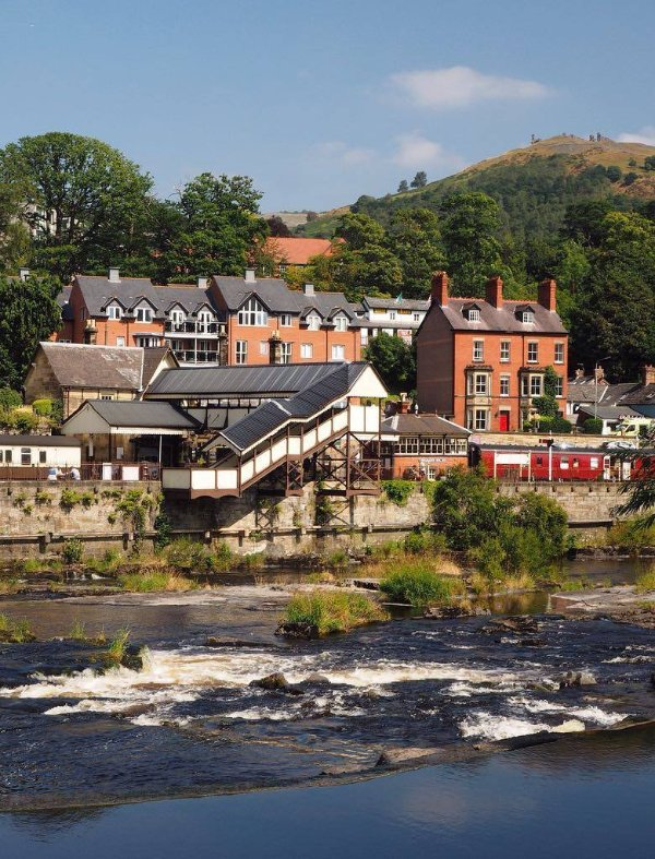 Llangollen - Steam trains, rafting & canoeing.  Lovely walks available in this riverside town.