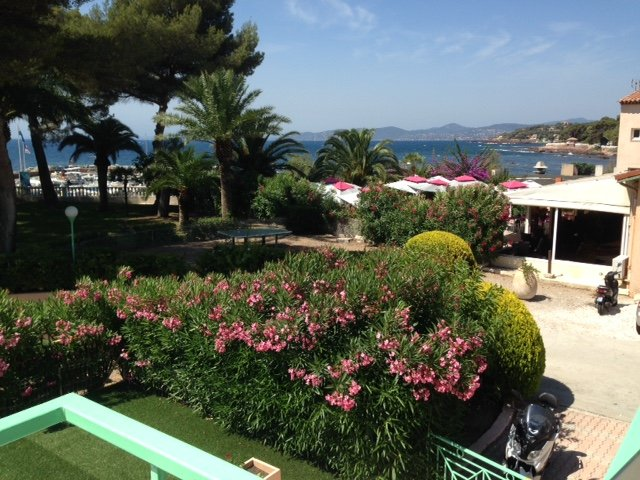view from the balcony towards the sea, and the adjoining restaurant
