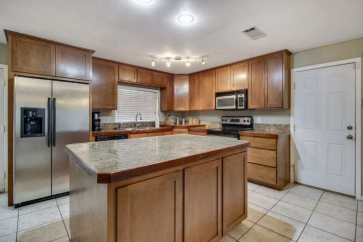 Spacious kitchen with refrigerator, dishwasher, microwave and lots of cupboard and counter space