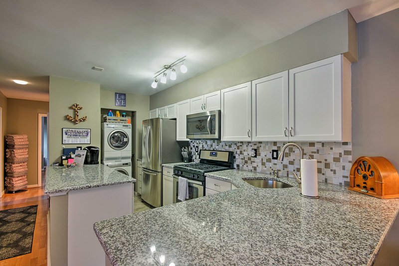 Admire the ample counter space and stainless steel appliances as you cook.