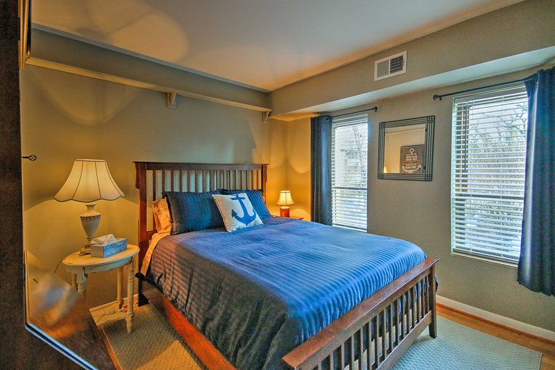 This bedroom comes complete with a cozy queen bed.