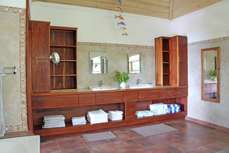 The master bathroom :- spacious with his and hers vanity units and mirrors.