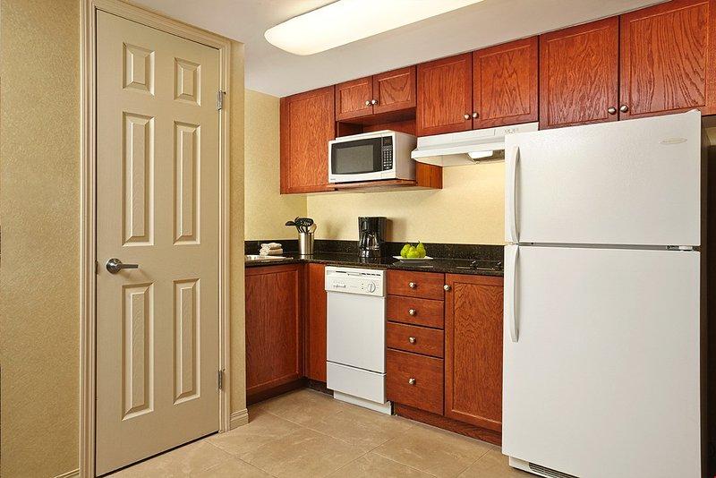 Un área de cocina hace que su estancia sea conveniente.