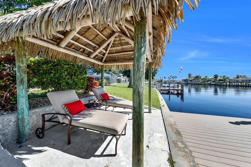 The private tiki hut down on the dock overlooking the wide direct Gulf access canal