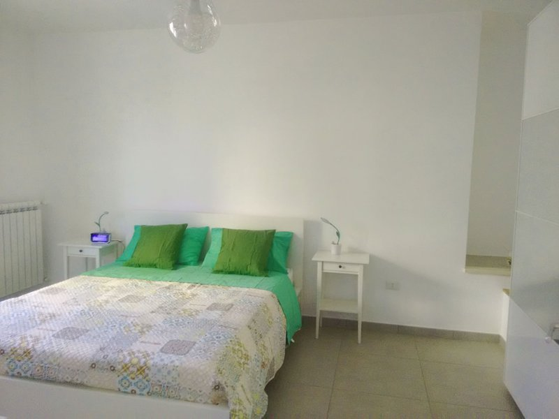 Double bedroom with wardrobe, window and TV