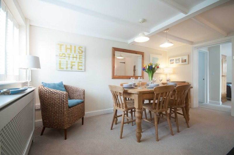Light and bright dining room with plenty of room for six