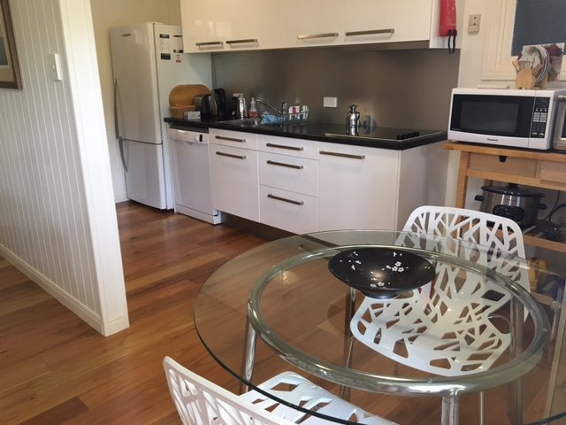 Fully equipped separate modern kitchen and dining with full sized fridge.