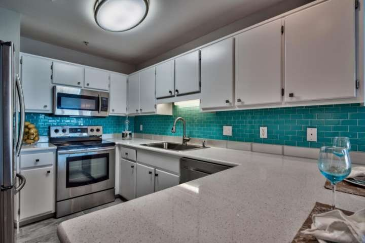 Fully remodeled kitchen with quartz counter tops and stainless steel appliances