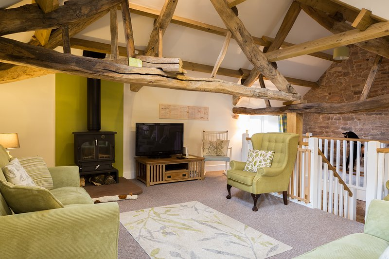 Beautiful open plan living space with original beams and exposed sandstone walls.